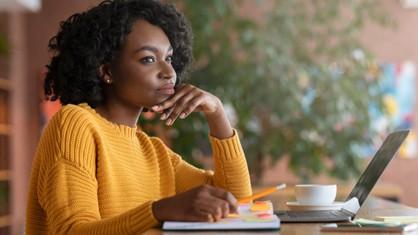 Woman thinking at a desk