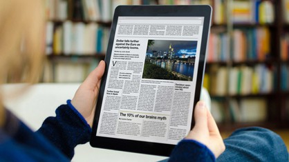 Woman using a tablet to look at a press release