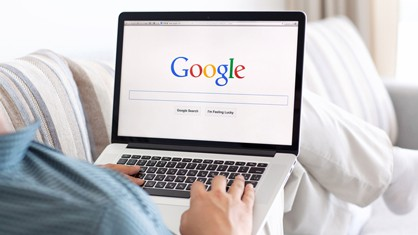 Person using Google on their laptop