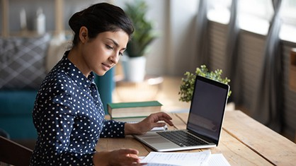 Woman creating a press release template with her laptop
