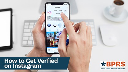 A person holding a phone that's open on a verified Instagram account.